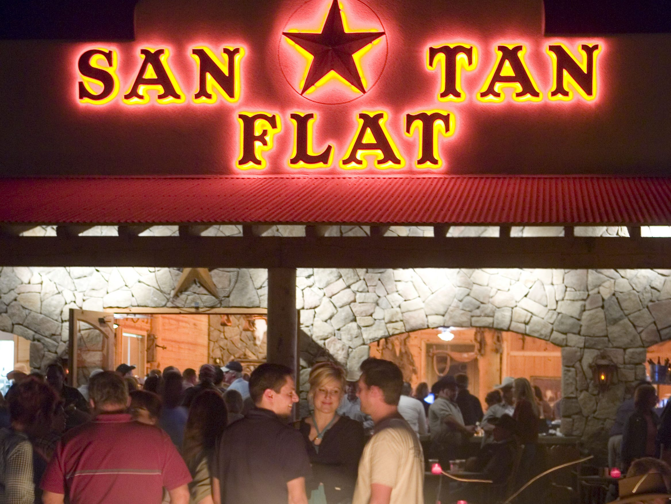 """San Tan Flat: Bummed about not camping at Country Thunder? Well, as the steakhouse's website states, it has """"all the fun of camping ... without having to sleep on the ground.""""San Tan Flat welcomes guests with an open-air bar filled with picnic tables and campfires forming a half-moon around a small stage.There's live music Wednesdays through Sundays, and it's a fun choice for families. Details:6185 W. Hunt Highway, Queen Creek. 480-882-2995, santanflat.com."""