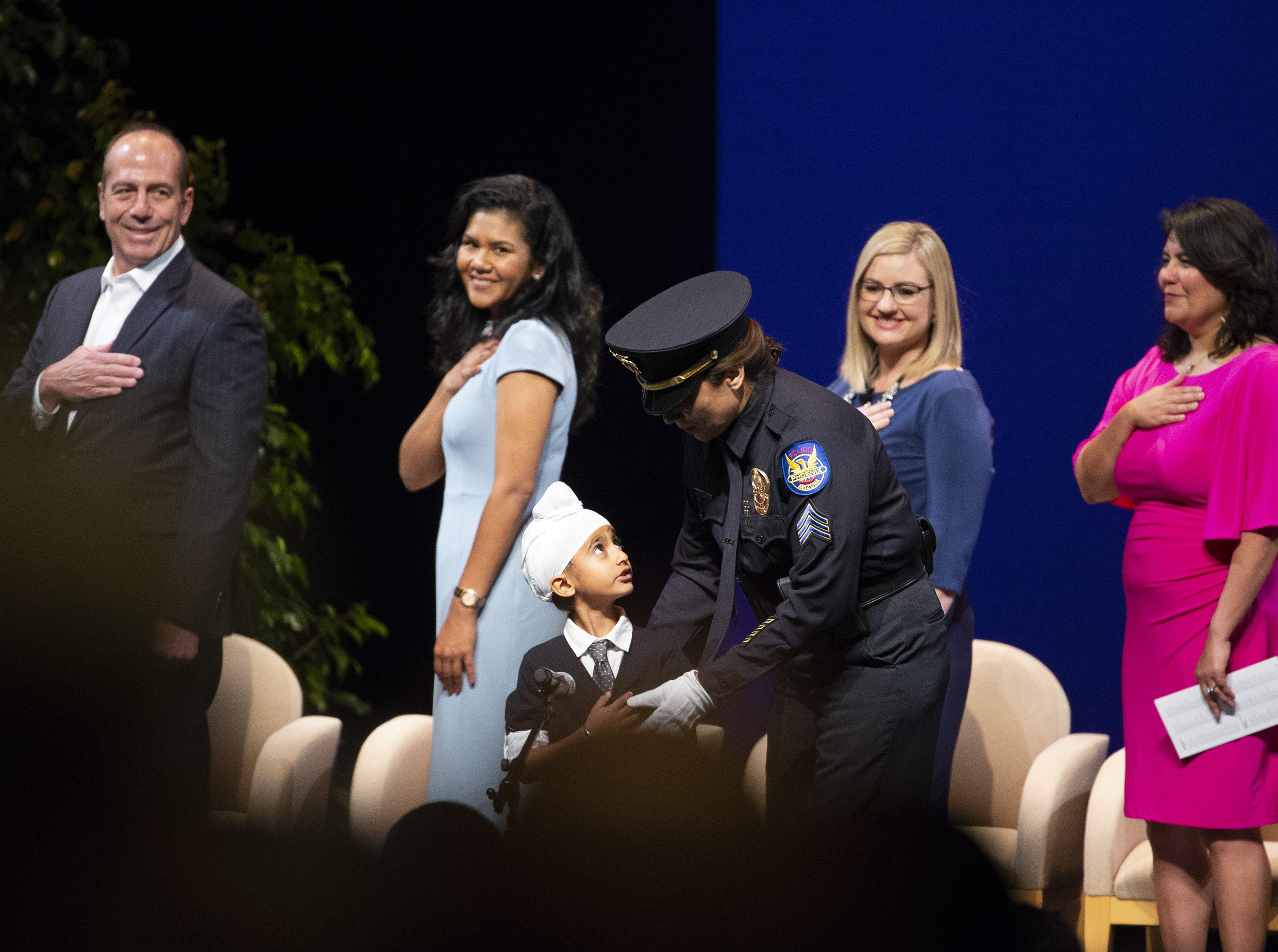 Anaik Singh Sachdev prepares to say the Pledge of Allegiance during Kate Gallego's inauguration ceremony as the new mayor of Phoenix on March 21 at the Orpheum Theatre in Phoenix, Ariz.