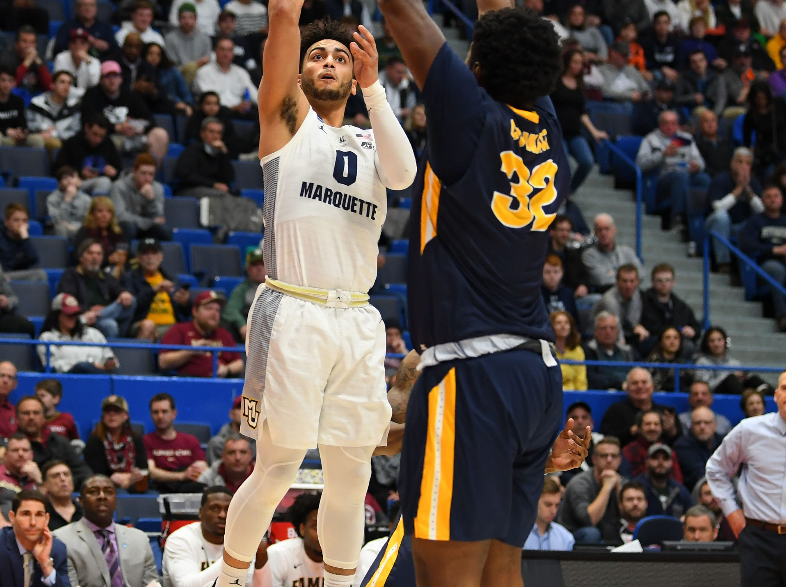 Mar 21, 2019; Hartford, CT, USA; Marquette Golden Eagles guard Markus Howard (0) attempts a shot past Murray State Racers forward Darnell Cowart (32) during the first half in the first round of the 2019 NCAA Tournament at XL Center. Mandatory Credit: Robert Deutsch-USA TODAY Sports