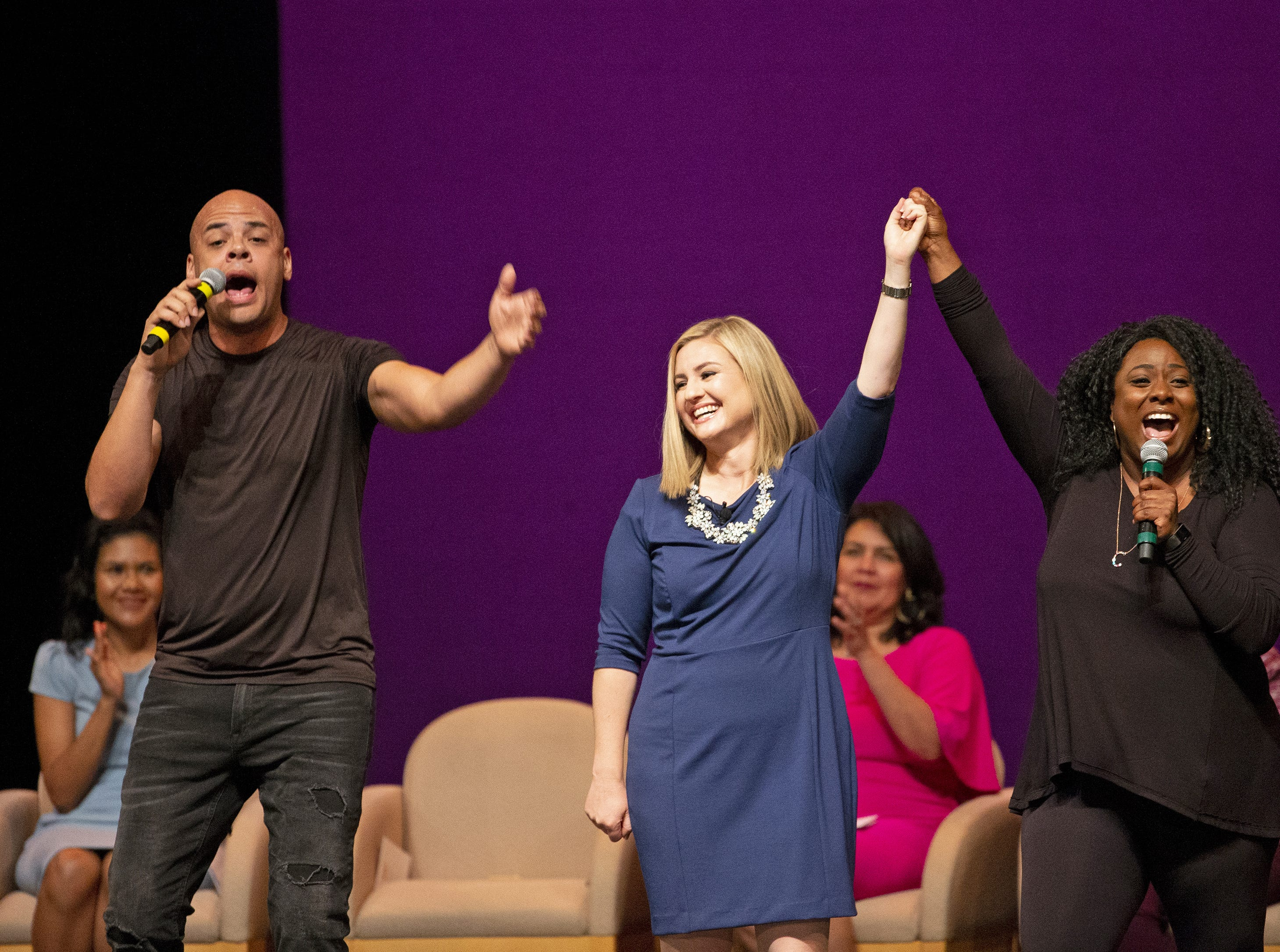 Kate Gallego celebrates during her inauguration ceremony as the new mayor of Phoenix with members of Bragg About It on March 21 at the Orpheum Theatre in Phoenix, Ariz.