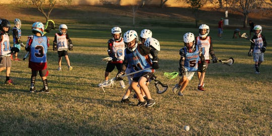 Several Scottsdale United players rush for the ball during a scrimmage at practice, Tuesday, March 19, 2019, at Cactus Park in Scottsdale, Arizona.