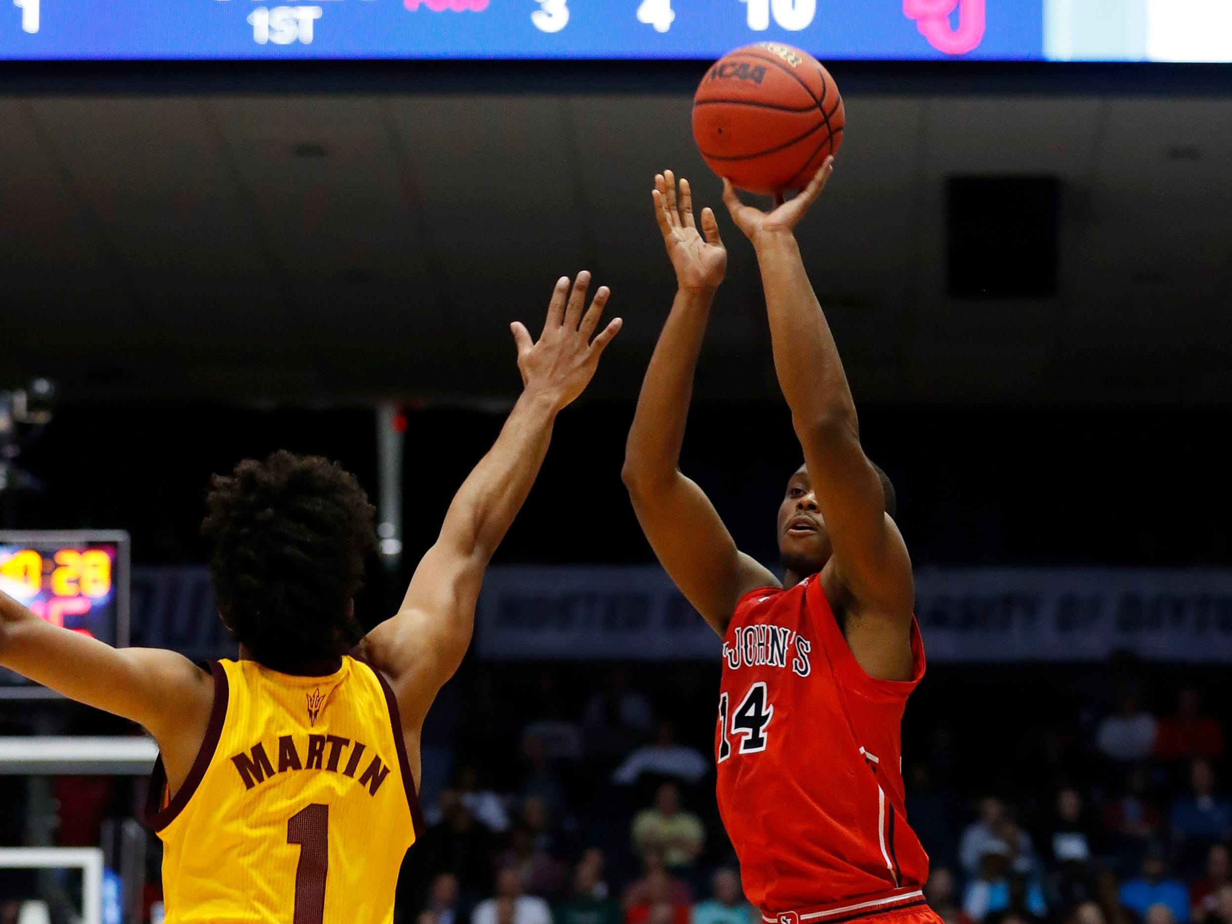 Mar 20, 2019; Dayton, OH, USA; St. John's Red Storm guard Mustapha Heron (14) shoots the ball over Arizona State Sun Devils guard Remy Martin (1) in the first half in the First Four of the 2019 NCAA Tournament at Dayton Arena. Mandatory Credit: Rick Osentoski-USA TODAY Sports