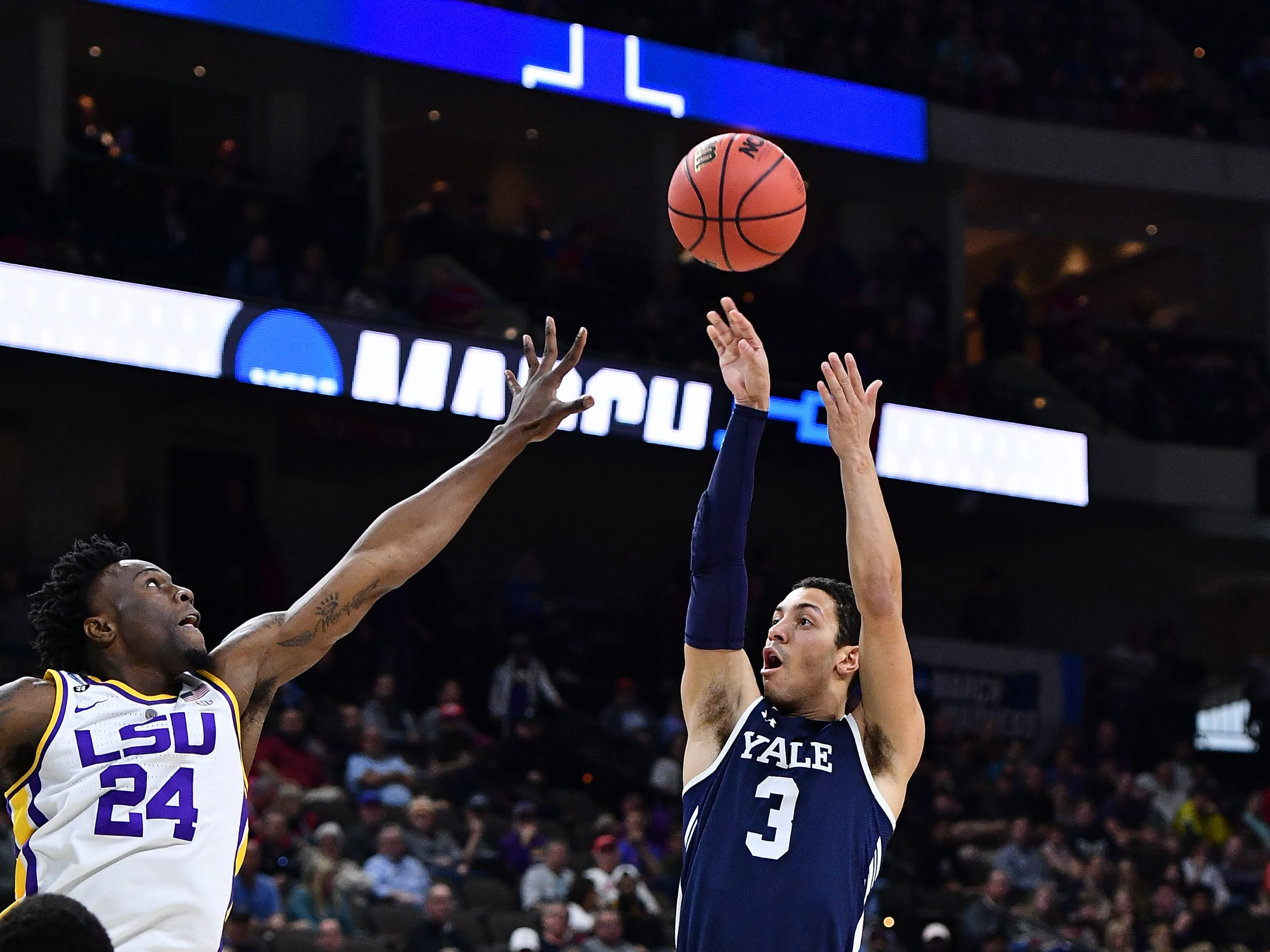 Mar 21, 2019; Jacksonville, FL, USA; Yale Bulldogs guard Alex Copeland (3) shoots against LSU Tigers forward Emmitt Williams (24) during the first half in the first round of the 2019 NCAA Tournament at Jacksonville Veterans Memorial Arena. Mandatory Credit: John David Mercer-USA TODAY Sports