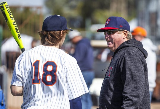 Arizona Diamondbacks area scout Mark Ross, right, speaks with Legend High School (Parker, Colorado) outfielder Hank Bard during the Scott Boras Classic tournament at Corona del Sol High School in Tempe, Wednesday, March 13, 2019.          .