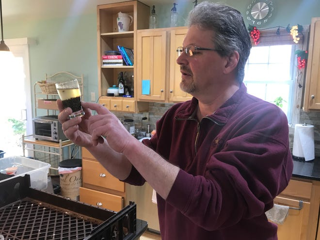 William Hartmann, owner of Royal Oaks vineyard and winery in North Cornwall Township, shows off industrial hemp seeds he plans to grow this year.