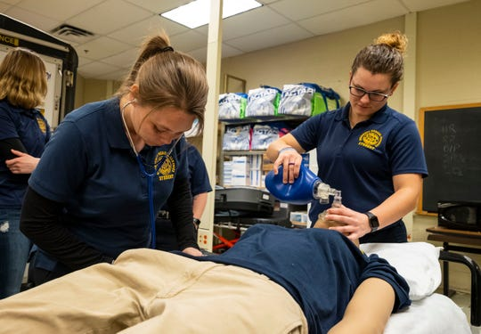 Amanda Aldridge, left, practices checking blood pressure on a training mannequin while Tori Fite practices ventilating during a drill Thursday, March 21, 2019 at SC4.