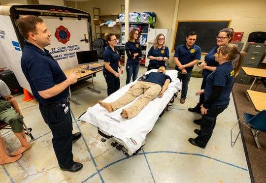 SC4 Paramedic Instructor Brandon Fey, left, leads a class of EMS students in a drill requiring students to answer questions while performing different tasks Thursday, March 21, 2019 in a classroom in SC4's Applied Technology Center.