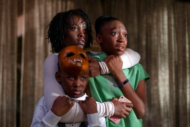 "From left, Evan Alex, Lupita Nyong'o and Shahadi Wright Joseph star in ""Us,"" written, produced and directed by Jordan Peele. The movie is playing at Regal West Manchester Stadium 13 and R/C Hanover Movies."
