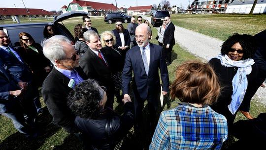 """Pennsylvania Gov. Tom Wolf greets a local group before speaking Wednesday, March 20, 2019. Wolf appeared at the York Fairgrounds as part of his tour across the commonwealth to stump for """"Restore Pennsylvania,"""" a $4.5 billion infrastructure plan. Bill Kalina photo"""