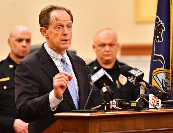 Sen. Pat Toomey (R-PA), front, discusses the Blocking Deadly Fentanyl Imports Act at the York County Administrative Building in York City, Thursday, March 21, 2019. The bipartisan legislation would hold fentanyl-producing nations accountable for their compliance with United States fentanyl-related drug enforcement. Dawn J. Sagert photo