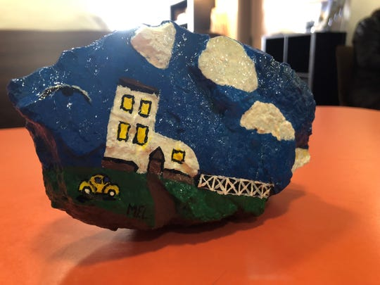 A customer left a painted rock March 20, 2019 in honor of Melanie Schmuck, co-owner of The Haines Shoe House, who died suddenly Feb. 28. Painted rocks are part of a national movement to spread positivity. (Photo by: Lindsay C. VanAsdalan)