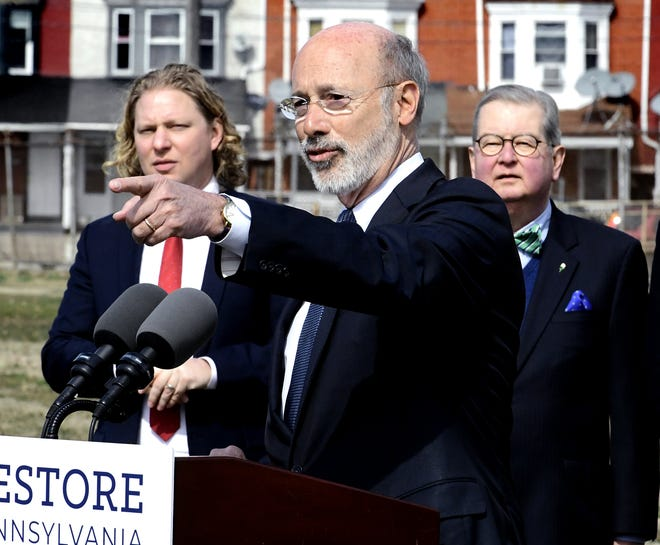 """Pennsylvania Gov. Tom Wolf appears with York County Economic Alliance CEO Kevin Schreiber, left, and York City Commissioner Henry Nixon at the York Fairgrounds Wednesday, March 20, 2019. Wolf's stop was part of his tour across the commonwealth to stump for """"Restore Pennsylvania,"""" a $4.5 billion infrastructure plan. Bill Kalina photo"""