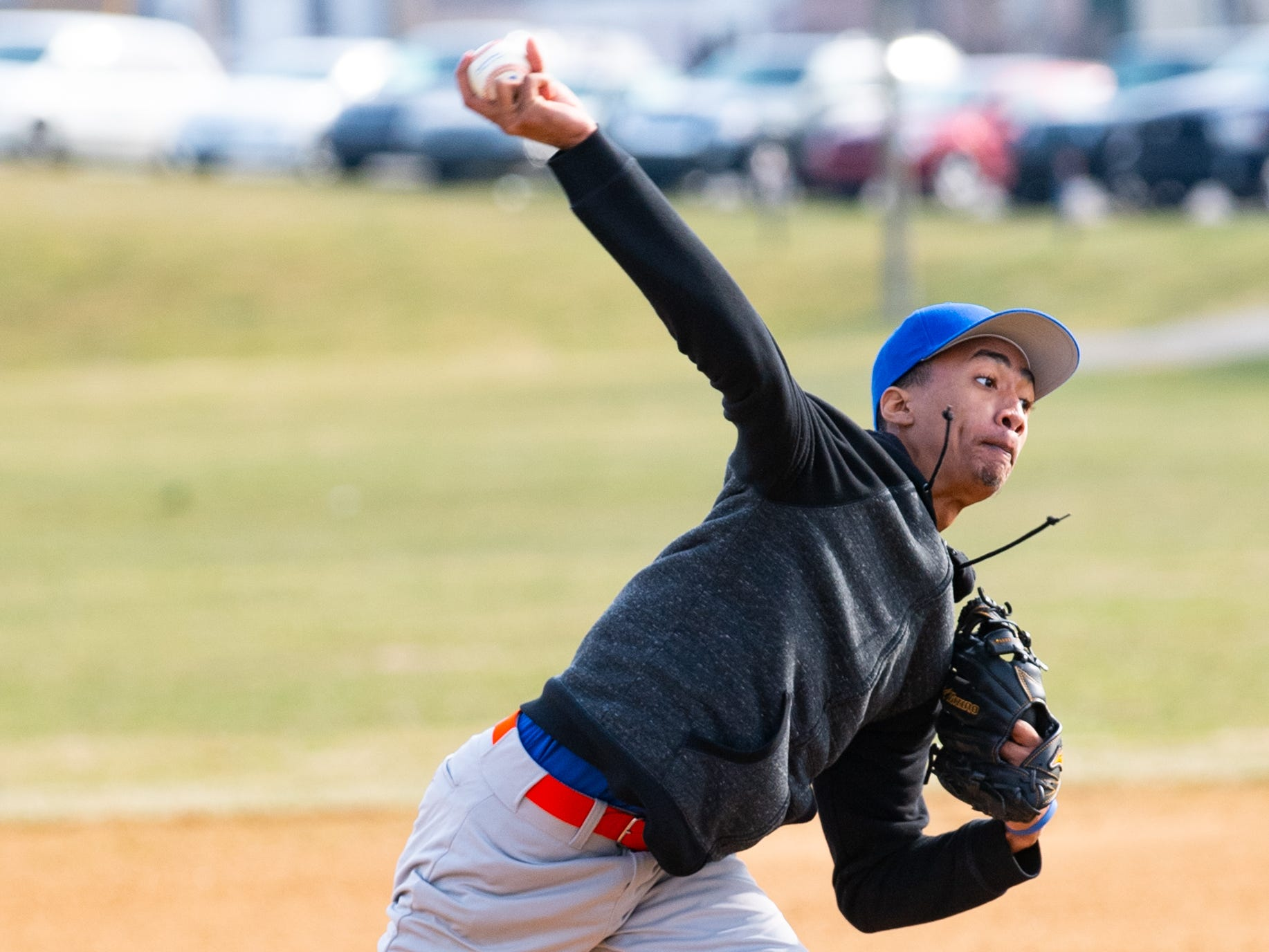 Rafael (10) puts power behind the pitch during York High's scrimmage against Steel High, March 20, 2019 at Small Athletic Field.