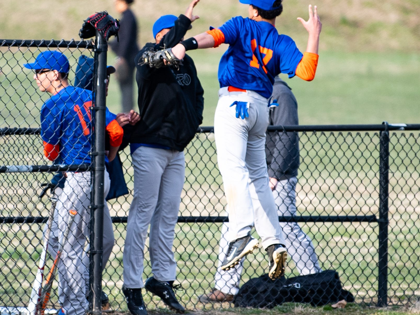 York High celebrates after completing a double play to end the inning during their scrimmage against Steel High, March 20, 2019 at Small Athletic Field.