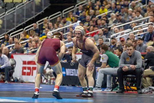 Chance Marsteller starts his opening-round NCAA Championships victory over Minnesota's Carson Brolsma.