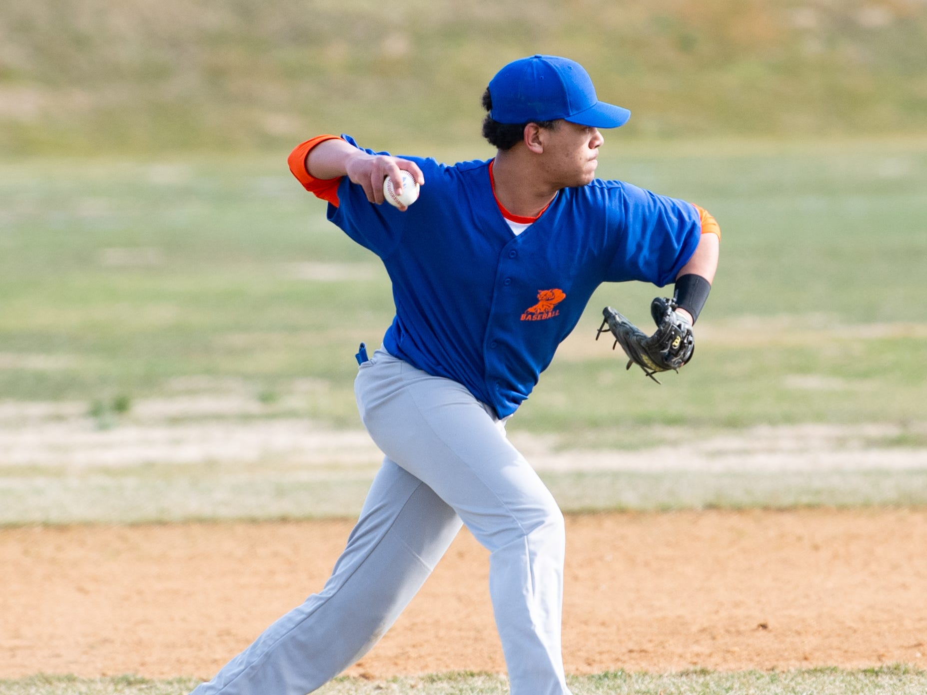 Erick Polanco (17) throws to first base during York High's scrimmage against Steel High, March 20, 2019 at Small Athletic Field.