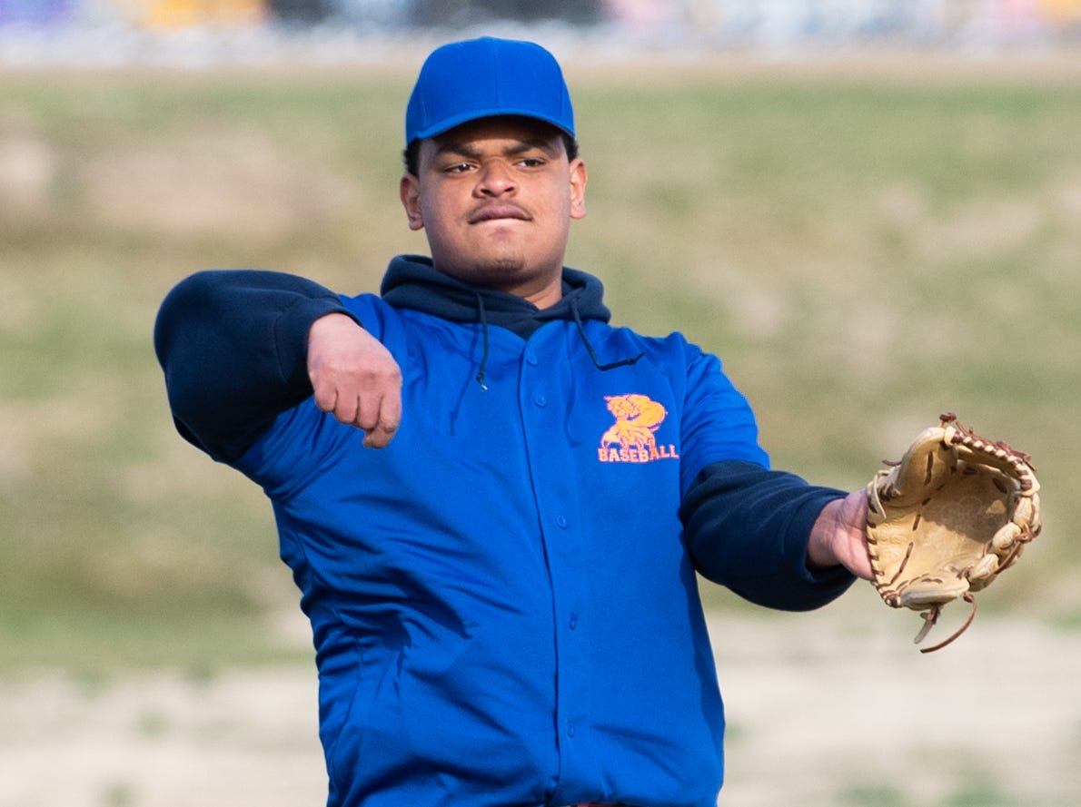 Joseph Garabito (22) tosses the ball to a teammate while Steel High changes batters during York High's scrimmage, March 20, 2019 at Small Athletic Field.