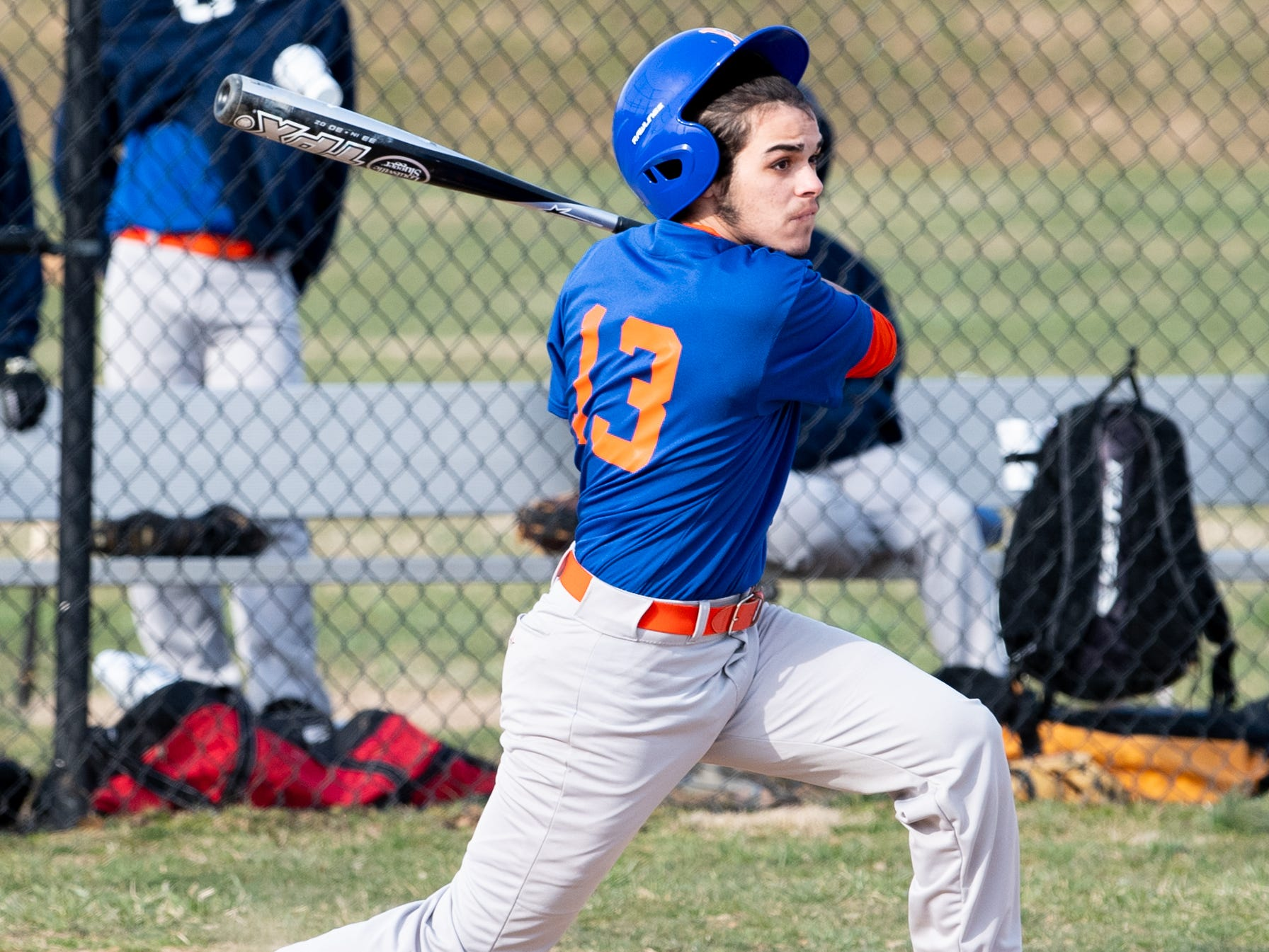 Bryan Soto (13) follows through on his swing during York High's scrimmage against Steel High, March 20, 2019 at Smalls Athletic Field.