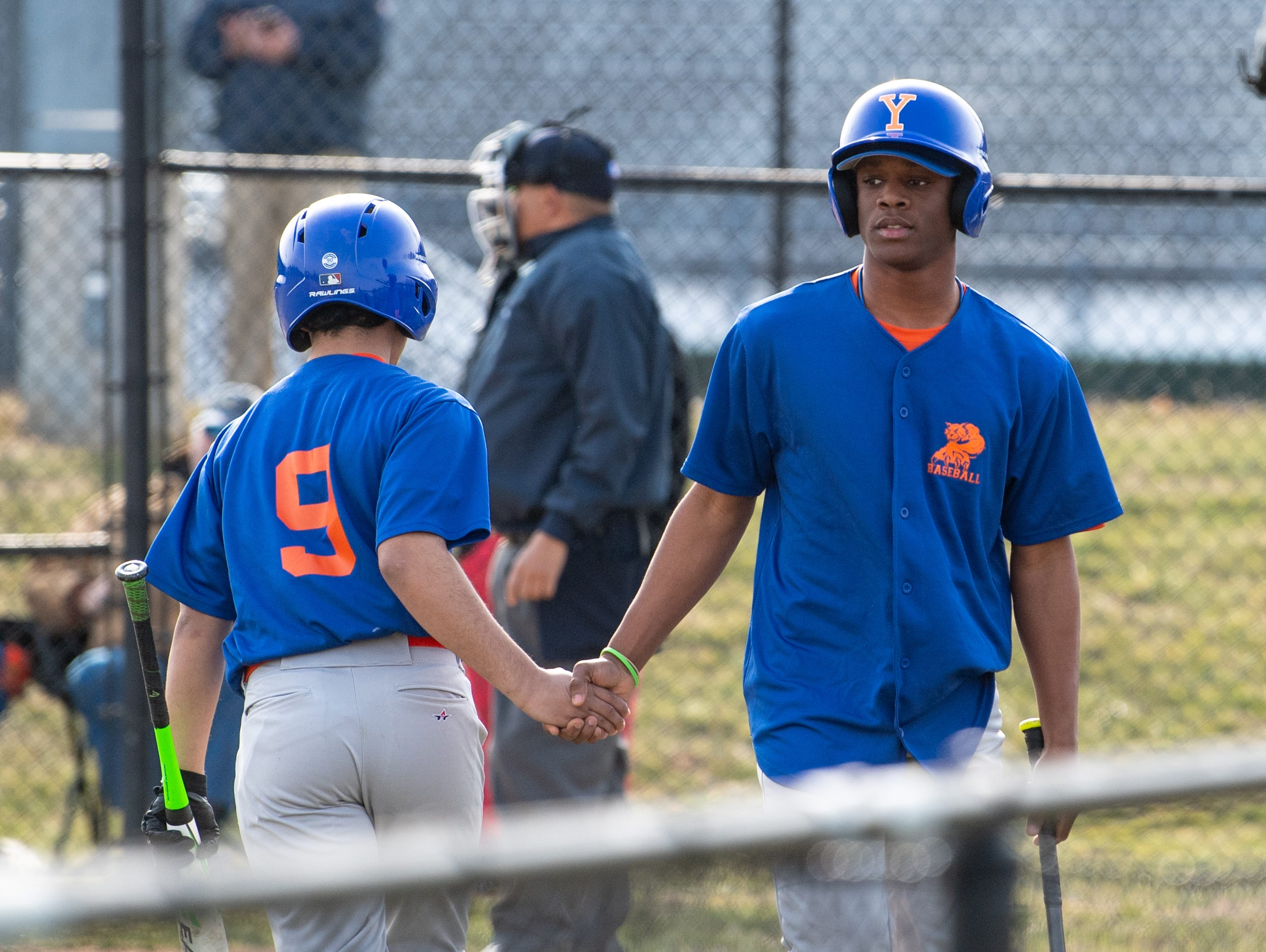 Marcellus John (15) heads to the bench after striking out during York High's scrimmage against Steel High, March 20, 2019 at Smalls Athletic Field.