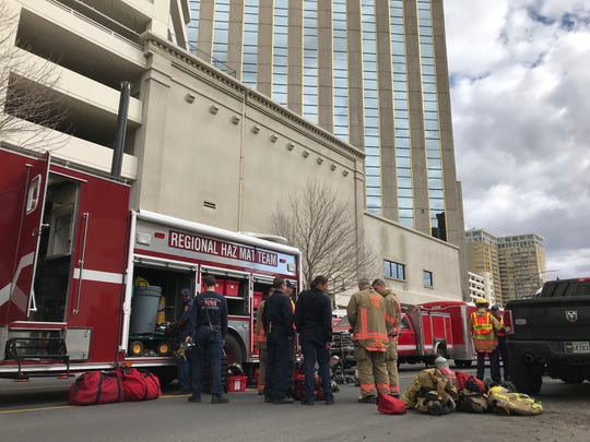 Firefighters and members of the regional hazmat team stand on Fourth Street outside the Silver Legacy in downtown Reno on Thursday, Mar. 21. The Reno Fire Department is responding to a possible hazmat situation inside the building.