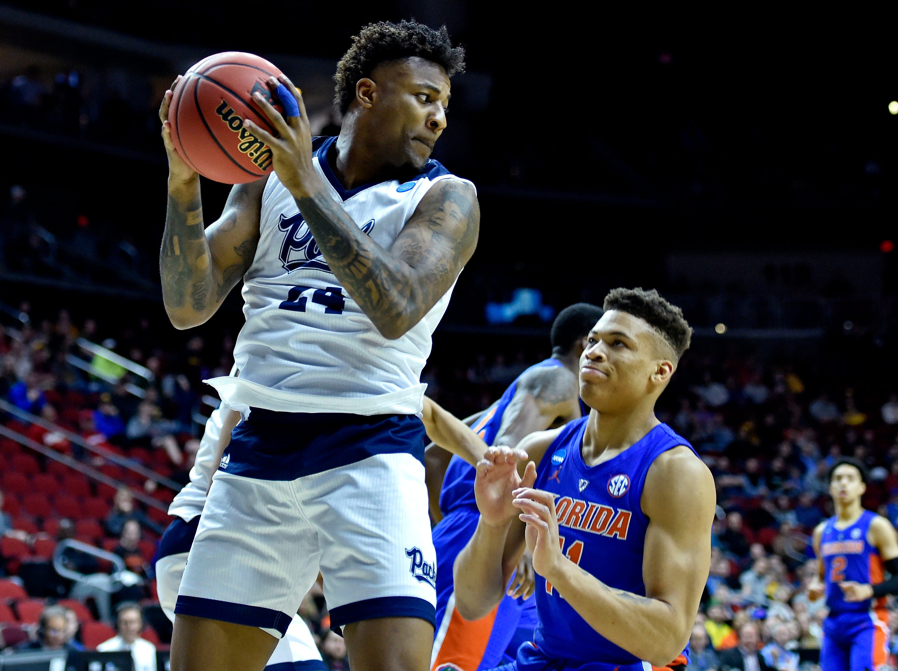 Mar 21, 2019; Des Moines, IA, United States; Nevada Wolf Pack forward Jordan Caroline (24) gets a rebound over Florida Gators forward Keyontae Johnson (11) during the first half in the first round of the 2019 NCAA Tournament at Wells Fargo Arena. Mandatory Credit: Jeffrey Becker-USA TODAY Sports