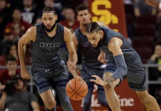 Nevada forwards Cody Martin, right, and Caleb Martin are two of the 40 draft prospects invited to the NBA G League's Elite Camp.