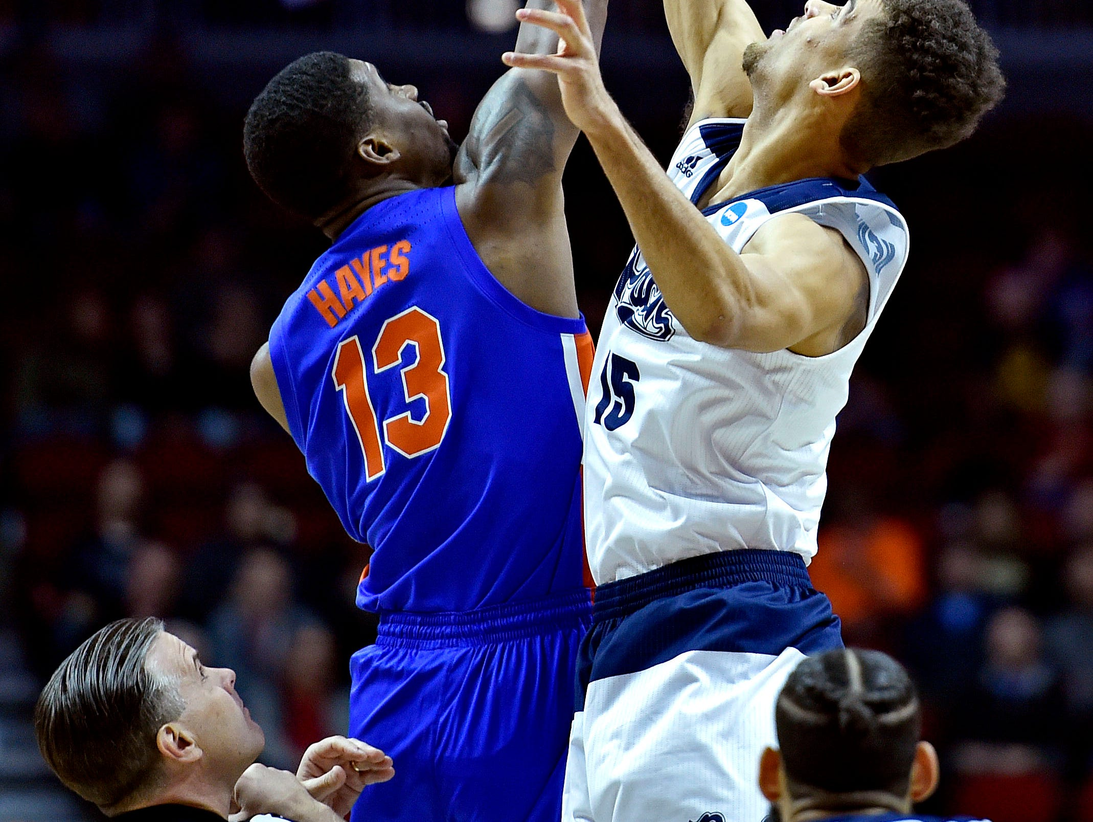Mar 21, 2019; Des Moines, IA, United States; Florida Gators center Kevarrius Hayes (13) and Nevada Wolf Pack forward Trey Porter (15) go for the opening tip in the first round of the 2019 NCAA Tournament at Wells Fargo Arena. Mandatory Credit: Jeffrey Becker-USA TODAY Sports