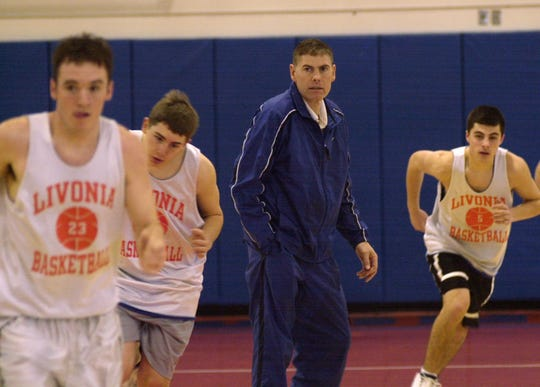 Tom Downey watches his 2002-03 Livonia Bulldogs team run drills at the high school.