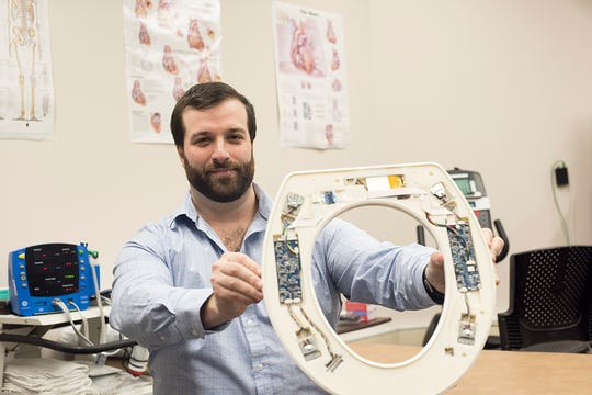 Nicholas Conn, a postdoctoral fellow at RIT and founder and CEO of Heart Health Intelligence, is part of the university team that has developed a toilet-seat based cardiovascular monitoring system.