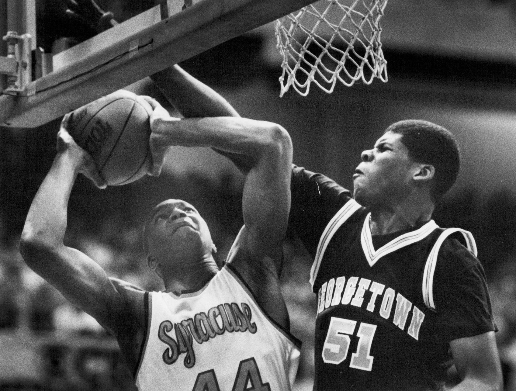 Syracuse star Derrick Coleman is fouled by Georgetown's Ben Gillery in this photo from #1988.