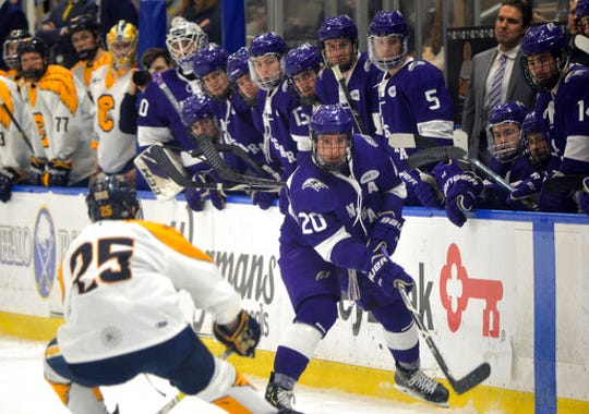 Niagara defenseman Noah Delmas moves the puck into the Canisius zone during a Feb. 22 game in Buffalo.