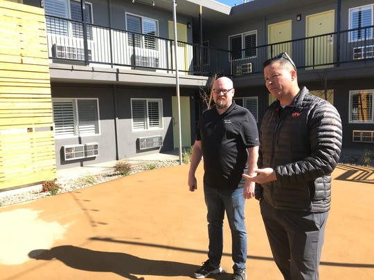 Brent Weaver, right, and Michael Atkinson, who is the hotel's general manager, talk about plans for the patio area.