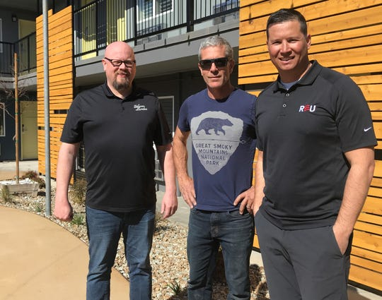 Americana Modern Hotel general manager Michael Atkinson, left, stands with managing partners Jamie Lynn, center, and Brent Weaver on March 21, 2019.
