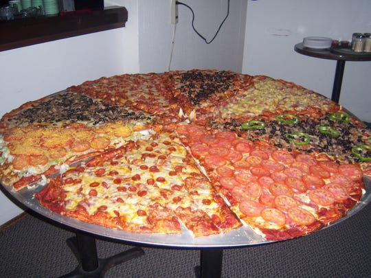 """Though it's not an official food challenge the 5-foot """"Giant Pizza"""" from JC's Pizzaria in Keizer is designed to feed a crowd."""