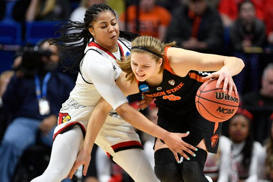 Mar 25, 2018; Lexington, KY, USA; Louisville Cardinals guard Arica Carter (11) pressures Oregon State Beavers guard Mikayla Pivec (0) during the first half in the championship game of the Lexington regional of the women's basketball 2018 NCAA Tournament at Rupp Arena. Mandatory Credit: Jamie Rhodes-USA TODAY Sports