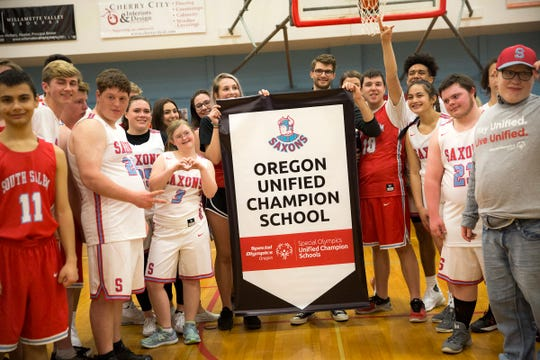 South Salem is presented with a banner during an assembly, which includes a unified basketball game, at South Salem High School in Salem on March 20, 2019.