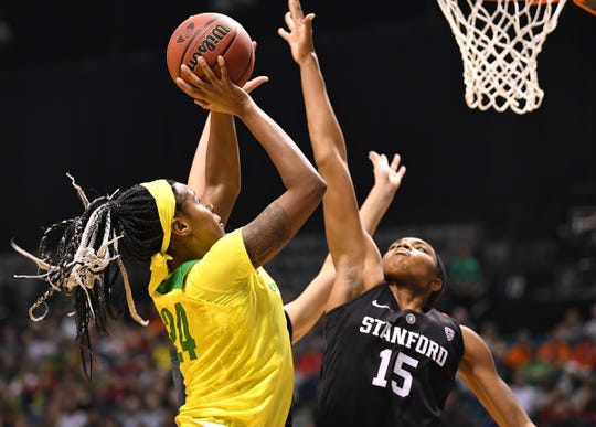 Mar 10, 2019; Las Vegas, NV, USA; Oregon Ducks forward Ruthy Hebard (24) shoots against Stanford Cardinal forward Maya Dodson (15) during the first half of the women's Pac-12 Conference Tournament final at MGM Grand Garden Arena. Mandatory Credit: Stephen R. Sylvanie-USA TODAY Sports