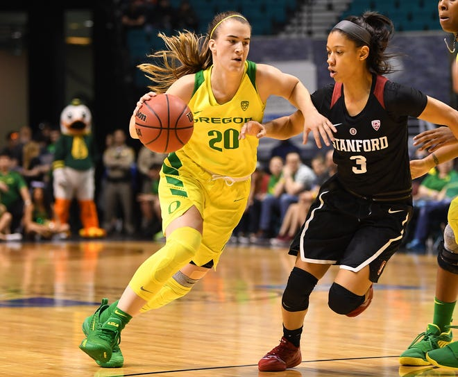 Mar 10, 2019; Las Vegas, NV, USA; Oregon Ducks guard Sabrina Ionescu (20) dribbles against Stanford Cardinal guard Anna Wilson (3) during the first half of the women's Pac-12 Conference Tournament final at MGM Grand Garden Arena. Mandatory Credit: Stephen R. Sylvanie-USA TODAY Sports