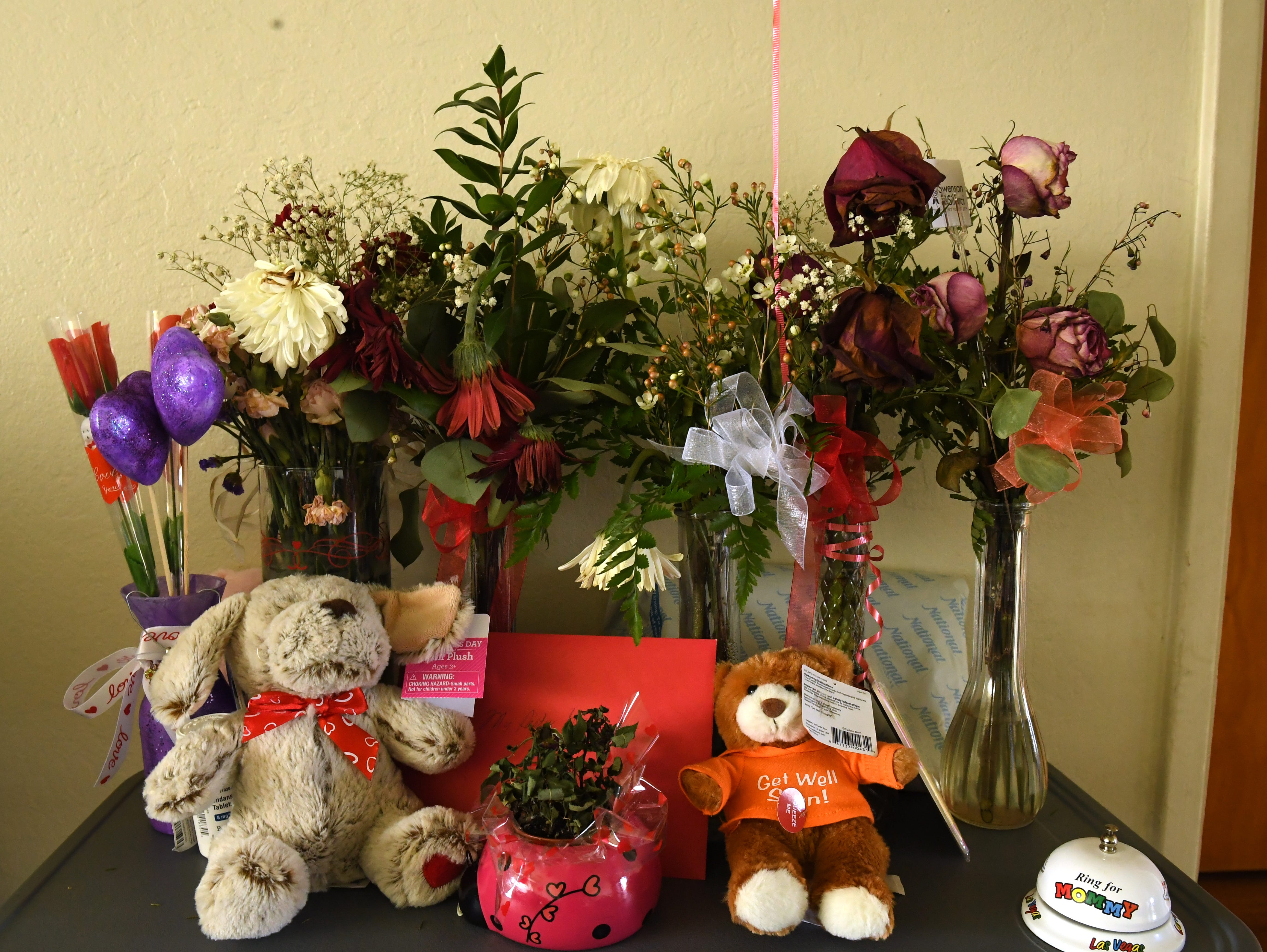 Flowers, dolls and other gifts sit on a table at Gloria Torrez' Salinas home.