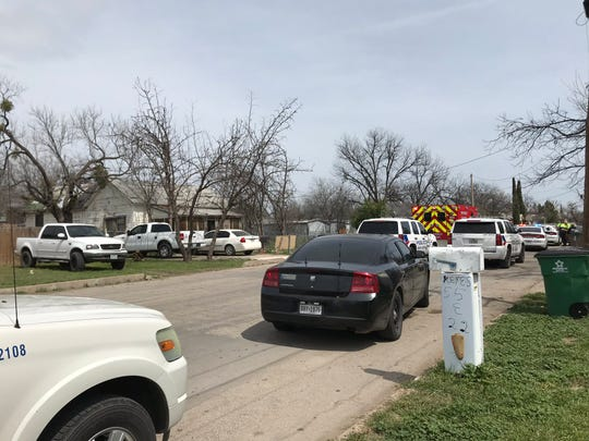 Police and ambulances arrive at a residence on East 22nd Street, Thursday, March 21, 2019.