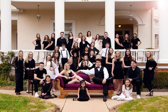 The members of Continuum Dance Company pose for a group photo. The company competes in four competitions before nationals each year.