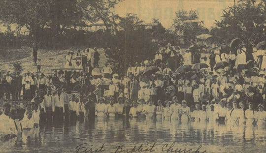 A large group prepares to receive baptism in the Concho River in this undated file photo, published in 1954. The area now known as San Angelo's Santa Fe Park was a popular site for baptisms with crossings at 1st and 6th streets.