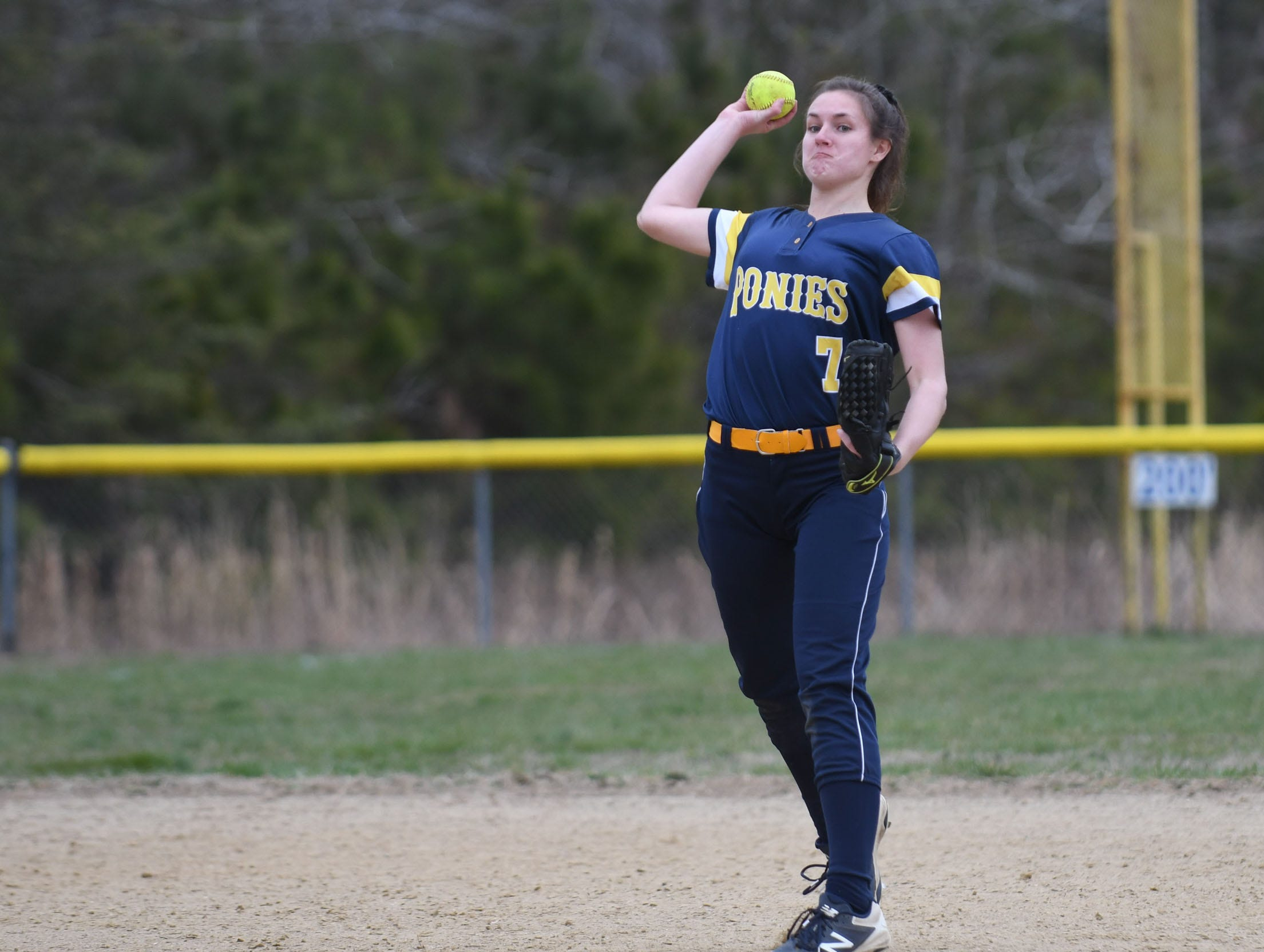 Chincoteague's Caroline Thornton makes the throw from short against Holly Grove on Wednesday, March 20, 2019 in Westover, Md.
