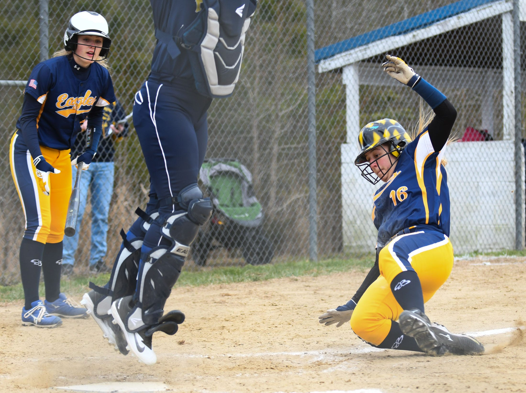 Holly Grove's Kayla Graziano slides into home against Chincoteague on Wednesday, March 20, 2019 in Westover, Md.