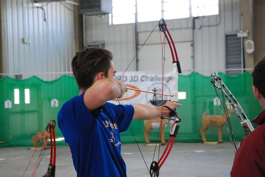 A member of the Holly Grove archery team competes at the Maryland NASP state championship on Saturday, March 16, 2019.