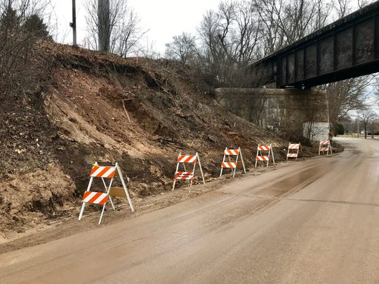 The slope along 17th Street where the city plans to repair following the flooding earlier this week as seen, Thursday, March 21, 2019, in Sheboygan, Wis.