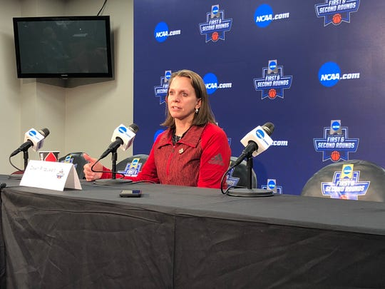 South Dakota women's basketball coach Dawn Plitzuweit addresses the media ahead of Thursday's practice session in Starkville, Miss. on March 21, 2019.