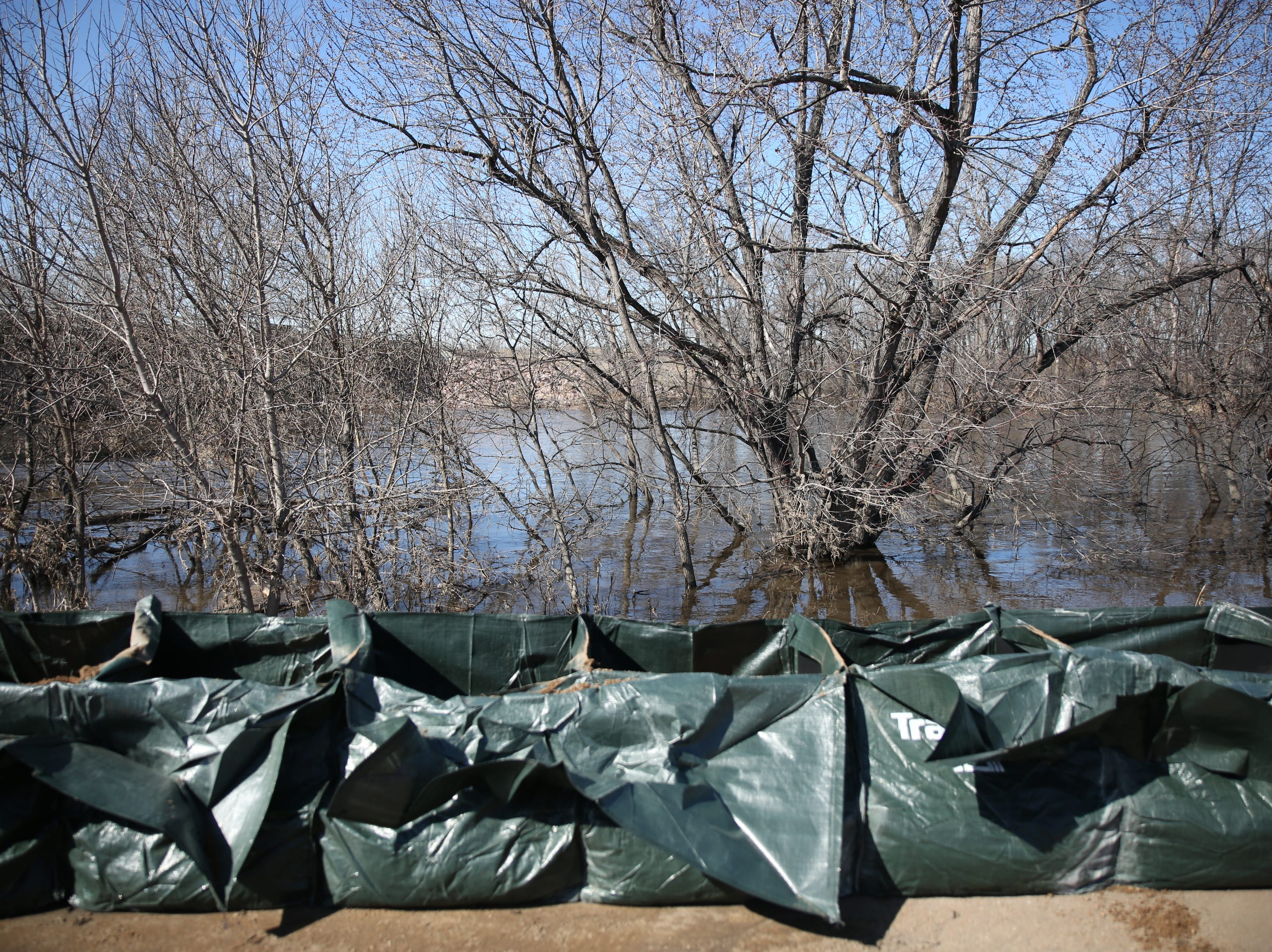 The City of Sioux Falls installed a trap bag system March 21, 2019 near the Lotta Street and Minnesota Avenue residential area in hopes of preventing flooding early next week. The trap bag system is a wall of two-foot tall plastic bags filled with sand and open on the top to allow water to fill the bag before overflowing.