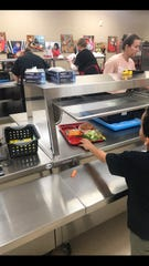Angel Dunham serves lunch at Fred Assam Elementary on Thursday, March 21, 2019.