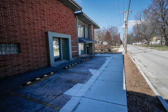 The city of Springfield put in a sidewalk and curb on Lombard Street, eliminating some parking spaces at McDaniel Furs.